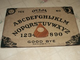 my_ouija_board_w_planchette_by_the_cosmic_queen-d5keeqa